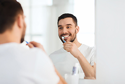 What Brushing with a Hard Toothbrush Can Do to Your Gums