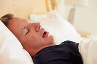 A man sleeping with his mouth open.
